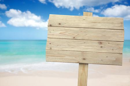 Photo pour A portrait of a vintage rustic wooden sign on the beach - image libre de droit