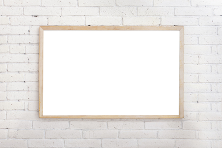 portrait of blank white board with wood frame on ehite brick wall