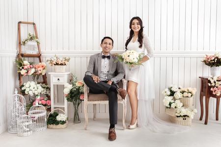 Photo pour pre wedding photos of romantic newlywed couple at decorated room - image libre de droit