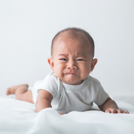 Photo for portrait of unhappy baby crying out loud - Royalty Free Image