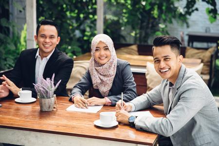 Photo pour portrait of Business people meeting in a cafe - image libre de droit