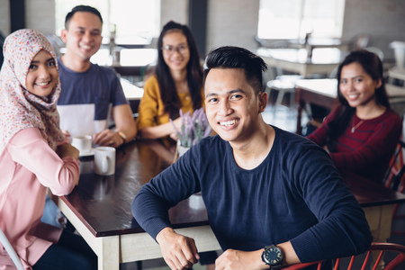 Photo for portrait of friends having fun together in a cafe. looking at camera - Royalty Free Image