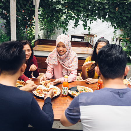 Photo for Group Of Young Friends Enjoying Meal In Outdoor Restaurant - Royalty Free Image