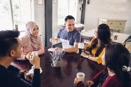 Photo for portrait of Cheerful group of friends having a conversation at the cafe - Royalty Free Image