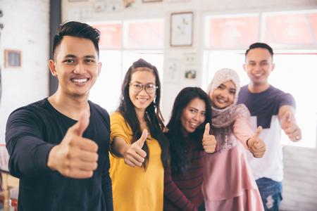 Photo pour Friends Thumbs up Togetherness Fun Concept - image libre de droit