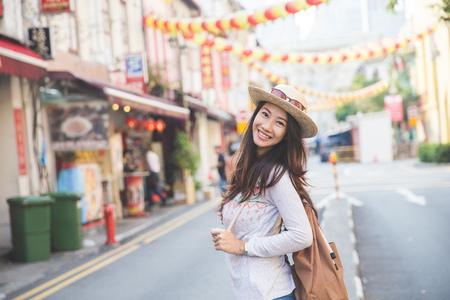 Foto de portrait of happy girl traveler ready to explore the city - Imagen libre de derechos
