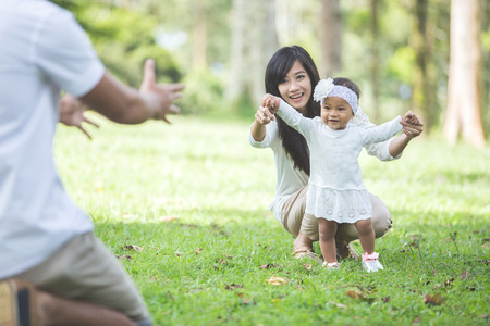 Photo for portrait of Beautiful baby learn to walk with their parent in the park - Royalty Free Image