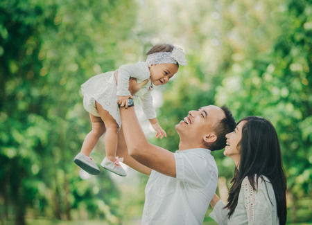 Photo for portrait of Beautiful family with cute baby in the park having fun together - Royalty Free Image