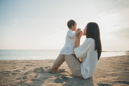Photo for Beautiful Mother And Baby outdoors. Mum and her Child together enjoying sunset - Royalty Free Image