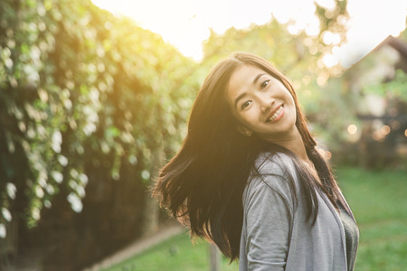 Photo pour portrait of happy attractive asian woman smiling to camera - image libre de droit