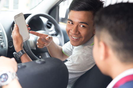 driver showing mobile phone to customer