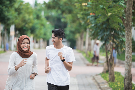 Photo for happy young asian couple exercise and warm up - Royalty Free Image