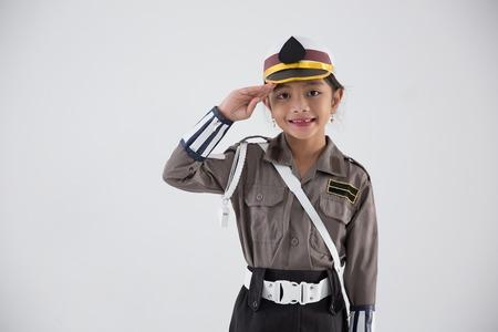 Photo pour kid pretending to be police officer - image libre de droit