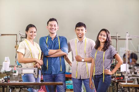 Photo pour group of workers in textile factory - image libre de droit