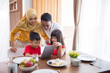 Photo for family using tablet pc at home - Royalty Free Image