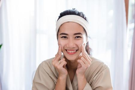 Photo pour Young woman self face  massage - image libre de droit
