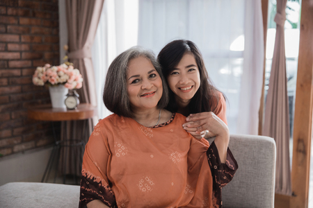 Photo for mature mother and her adult daughter smiling - Royalty Free Image