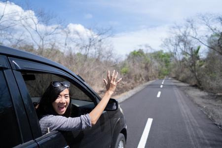Photo pour woman enjoying her trip going on vacation by car - image libre de droit