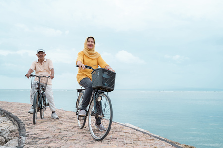 Photo for old couple ride bicycle together - Royalty Free Image