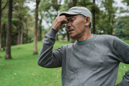Photo pour senior asian man having headache - image libre de droit