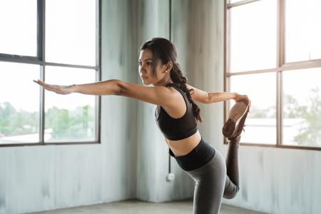 Foto de woman in sport wear doing some yoga pose - Imagen libre de derechos