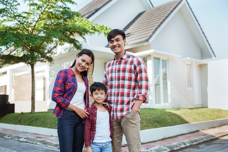 Photo for asian family with kid portrait in front of their house - Royalty Free Image