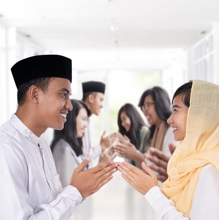 Photo for man and woman greeting in muslim traditional way - Royalty Free Image