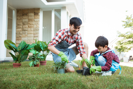 Foto de father and son gardening at home in the morning - Imagen libre de derechos