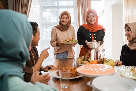 Photo for muslim people having some food together - Royalty Free Image