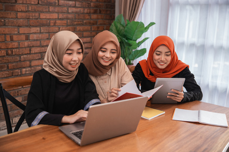 Photo for student discussing together using laptop - Royalty Free Image