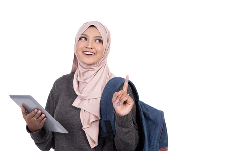 Photo pour muslim student with tablet pointing and thinking - image libre de droit