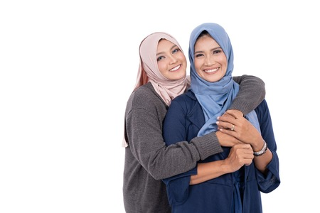 Foto de muslim mother and daughter isolated - Imagen libre de derechos
