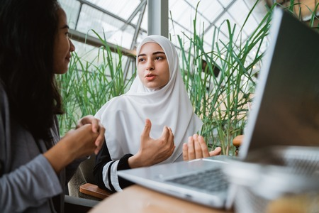Photo for arab muslim woman in conversation - Royalty Free Image