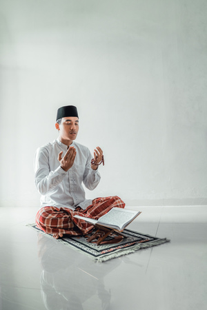 Photo for muslim asian man praying to god - Royalty Free Image