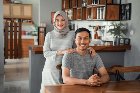 Photo for muslim couple sitting in dining room together - Royalty Free Image