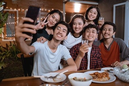 Photo for asian bestfriend group take selfie with smartphone while having garden party - Royalty Free Image