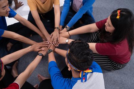 Photo pour asian friend holding hand stack together. - image libre de droit