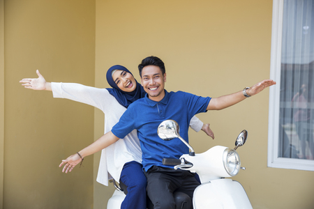 Photo for muslim couple riding motorcyle - Royalty Free Image