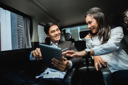 Foto de young business people meeting in the car - Imagen libre de derechos