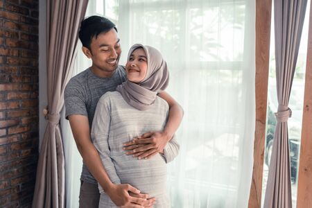 Photo for pregnancy muslim woman with husband - Royalty Free Image