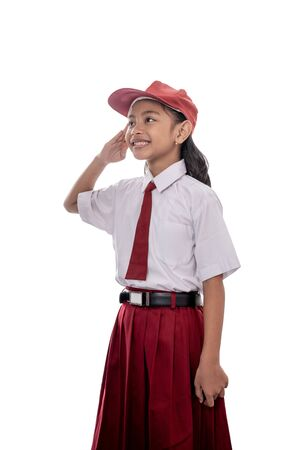 Foto per student giving salute while indonesia flag being raised - Immagine Royalty Free