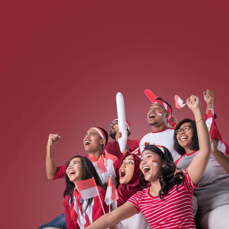 Photo for indonesian supporter watching with excitement - Royalty Free Image