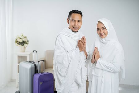 Photo for muslim pilgrims wife and husband ready for Hajj - Royalty Free Image