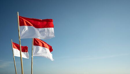 Photo for indonesia flags under blue sky independence day concept - Royalty Free Image