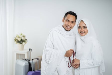 Photo for muslim pilgrims wife and husband in white traditional clothes - Royalty Free Image