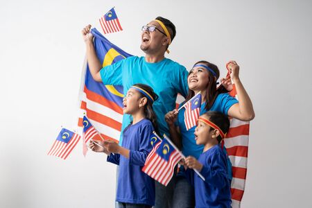 Photo for malaysia family with attributes and flag celebrating - Royalty Free Image