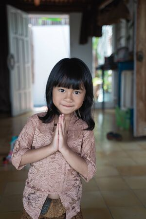 Photo for welcome greeting from asian cute little girl - Royalty Free Image