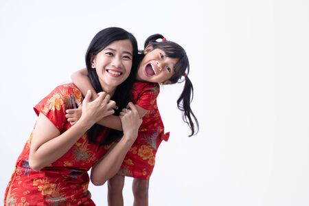 Photo pour asian Chinese daughter and mother smile and hug together - image libre de droit