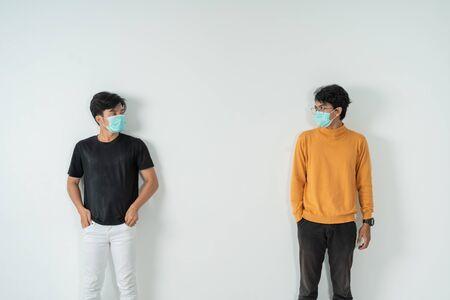 Photo pour Social distancing, people with masks - image libre de droit