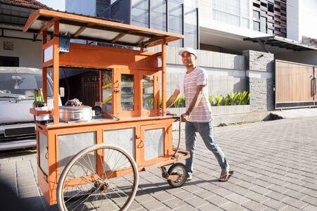Foto de man selling bakso in the carts - Imagen libre de derechos